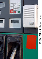 Green fuel pistols on fuel station - some fuel pumps at a...