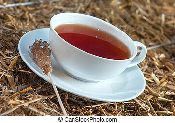 cup of tea on straw background