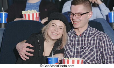 Couple at the session in the multiplex. Friends in cinema...