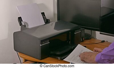 businessman man in office prints documents on printer typing...