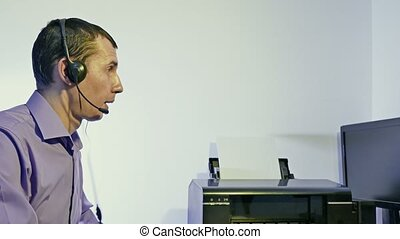 working man in call center support for computer with...