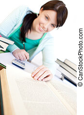 Charming woman studying at her desk
