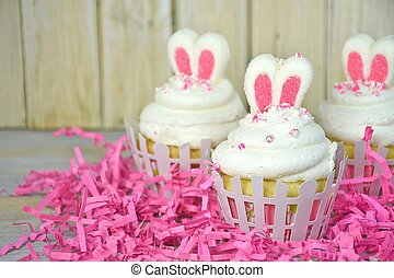 Easter bunny ears on cupcakes - Easter bunny ears in cupcake...