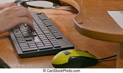 businessman man typing on the keyboard works at computer -...