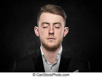 Young man in a suit sleeps. - Young man in a suit with his...