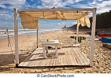 Beach hut - A wooden beach hut on a sandy beach