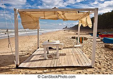 Beach hut - A wooden beach hut on a sandy beach