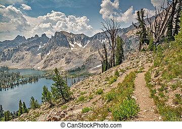 Mountain hilking trail leads the Idaho mountains - Foot path...