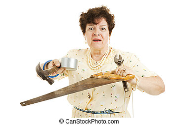 Overwhelmed by Home Improvements - Older lady holding tools....