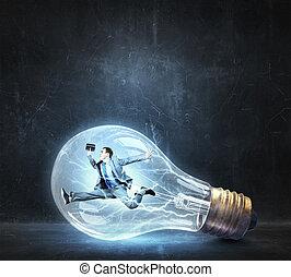 Man inside of electric bulb - Jumping businessman inside...