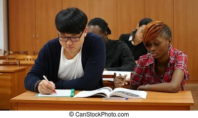 Group of Students at University Making Notes - Group of...