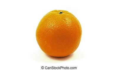 Orange Rotates Slowly On White - Single orange turning on...