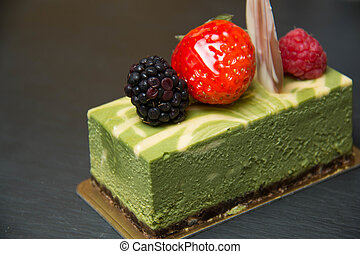 Green tea cheese cake ontop raspberry,bluberry,strawberry