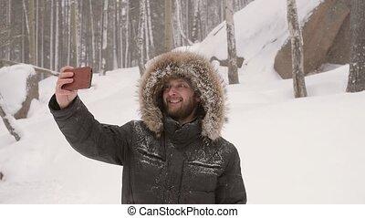 Man taking a winter selfie