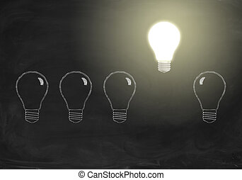 Shining realistic bulb in row with drawing bulbs on chalkboard. Idea concept