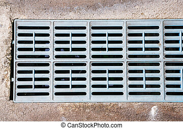 Plastic trench drain grates - Close up old and weathered...