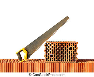 Brick wall with handsaw on bricks Bricklaying work