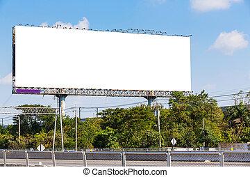 Billboard - Blank billboard on blue sky ready for new...