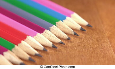 black lead pencils lie in a row ,