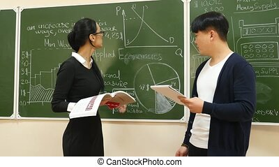 Teacher Explains a Subject to Student - Professor and...