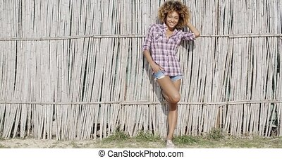 Young Woman Near A Wattled Fence - Fashion woman posing...