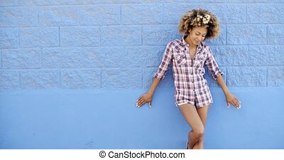 Girl Standing At The Blue Brick Wall - Full length portrait...
