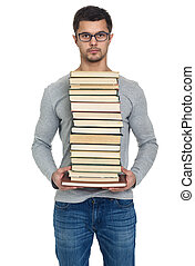 Young man with a pile of books in hands, isolated on white