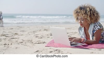 Woman At The Beach Working On A Laptop