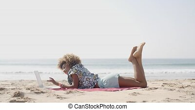 Happy Woman Typing On A Laptop On A Beach - Cute...