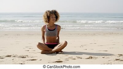 Girl Relaxing On A Beach - Slim girl on a beach in lotus...