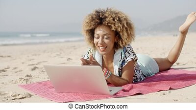 Girl Chatting Outdoor - Young african american woman smiling...