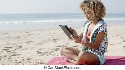 Woman Uses Touchpad Tablet On The Beach - Carefree woman...