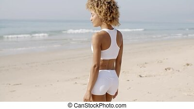 Young Woman Walking On The Beach In Summer - Happy smiling...