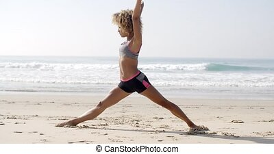 Woman Doing Twine On The Beach - Sporty woman doing...