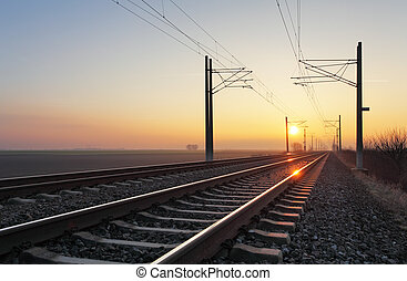 Railroad - Railway at sunset with sun