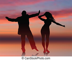 Man and woman dancing on summer sunset background
