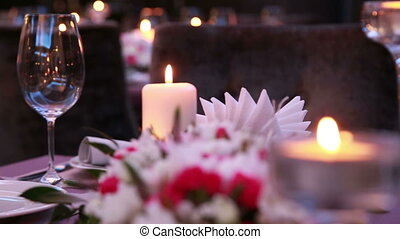 luxury expensive table serving for a festive holiday event with candles and roses