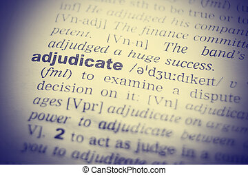 Dictionary definition of adjudicate. Close up view with paper textures