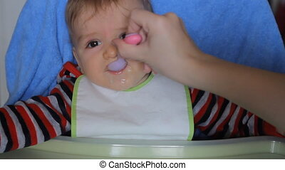 baby fed from a spoon HD