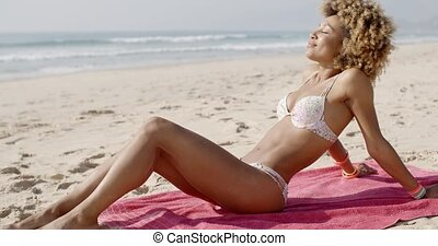 Beautiful Woman Sunbathing On A Beach - African-american...