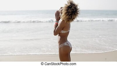 Girl In Bikini Posing Against Sea - Portrait of happy girl...