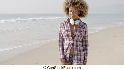 Girl With Headphones Walking On The Beach - Girl with big...
