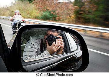 Paparazzi Photographer - A paparazzi photographer takes a...