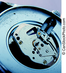 macro picture of a wrist watch clock mechanism