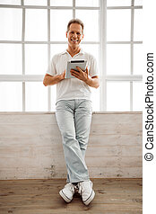 Middle aged man with gadget