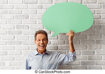 Man with speech bubbles - Handsome middle aged man is...