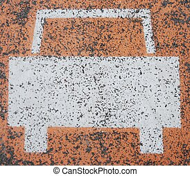 Car sign - white car road sign painted on a orange asphalt...