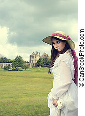victorian woman with manor house - young victorian woman...