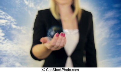 Woman holding a globe in her hand
