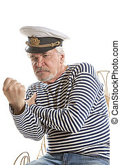 Old sailor man - Portrait of old sailor man in striped shirt...